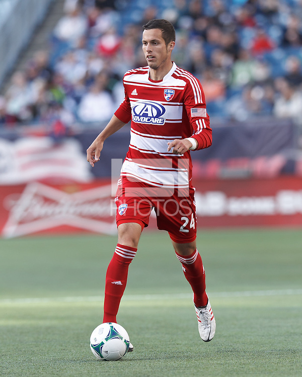 FC Dallas defender Matt Hedges (24) looks to pass..  In a Major League Soccer (MLS) match, FC Dallas (red) defeated the New England Revolution (blue), 1-0, at Gillette Stadium on March 30, 2013.