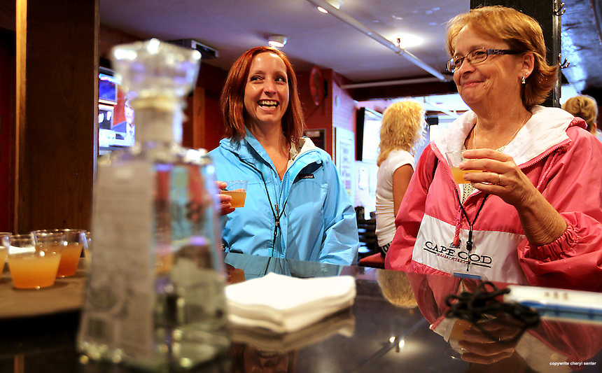 Enjoying Fat Island Ice Teas at Fat Belly's are from left, Holly McGonagle of Concord, N.H., and Betsy Gagnon of Concord, during the 6th Annual Portsmouth Cocktail Competition in Portsmouth, N.H., Sunday, June 3, 2012.  (Portsmouth Herald Photo Cheryl Senter)