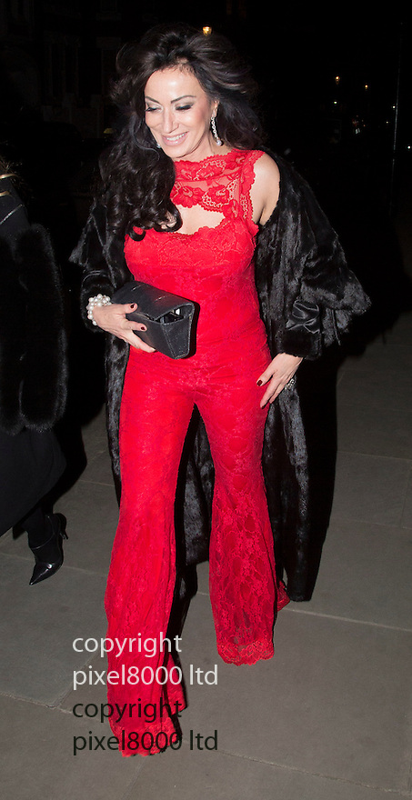 Pic shows: Antony Price's 70th birthday party in London.<br /> Held at Blakes Hotel,.<br /> <br /> <br /> Nancy Dell'Olio, 53, arrived (with Sarah Esqulant Giles) while wearing a racy red backless jumpsuit.<br /> <br /> <br /> <br /> <br /> <br /> <br /> <br /> picture by Gavin Rodgers/ Pixel