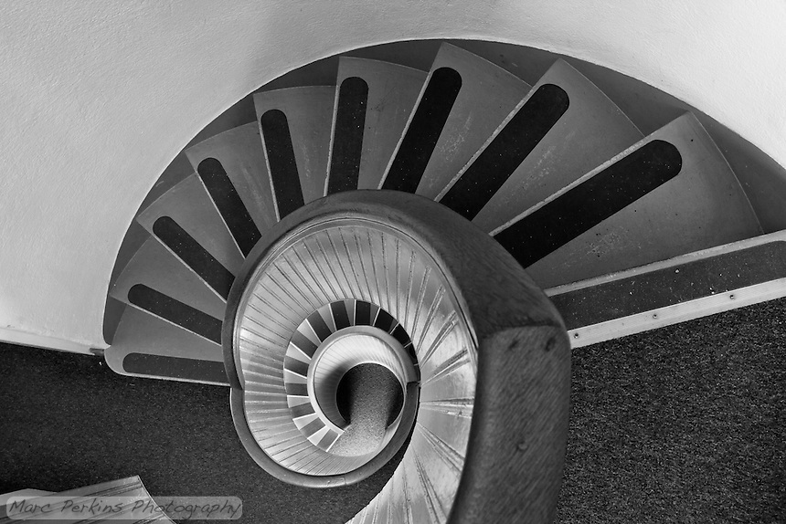 Lighthouse staircases are just plain awesome, and Old Point Loma Light's stairway in Cabrillo National Monument is no exception.  Greg and I spent a good half hour up at the top trying various compositions, waiting for people to stop walking in, and admiring the Nautilus-like stairway.  To bring out the textures and lines I prefer this in black and white, especially since the colors aren't particularly grabbing.