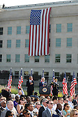 United States President Barack Obama, U.S. Secretary of Defense Chuck Hagel, and Chairman of of the Joint Chiefs of Staff General Martin Dempsey listen to the National Anthem during a remembrance at the 12th anniversary commemoration of the 9/11 terrorist attacks at the Pentagon Memorial at the Pentagon in Washington, DC on September 11, 2013. Nearly 3,000 people were killed in the attacks in New York, Washington and Shanksville, Pennsylvania. <br /> Credit: Pat Benic / Pool via CNP