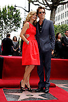 "US actress Kyra Sedgwick is posing with husband Kevin Bacon as she receives the 2,384th Star on the Hollywood Walk of Fame, Los Angeles, California, USA, on June  8, 2009. Bacon's star is next to hers. Kyra Sedgwick was born in New York in 1965 and grew up in Manhattan.  She made her professional acting debut at the age of 16 on the soap opera ""Another World."" .Photo by Nina Prommer/Milestone Photo"