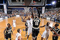 18 November 2010:  FIU's Eric Frederick (15) puts up a shot in the second half as the Florida State University Seminoles defeated the FIU Golden Panthers, 89-66, at the U.S. Century Bank Arena in Miami, Florida.