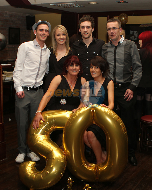 Mary McGinn with her family celebrating her 50th in McHughs...(Photo credit should read Jenny Matthews/NEWSFILE)...