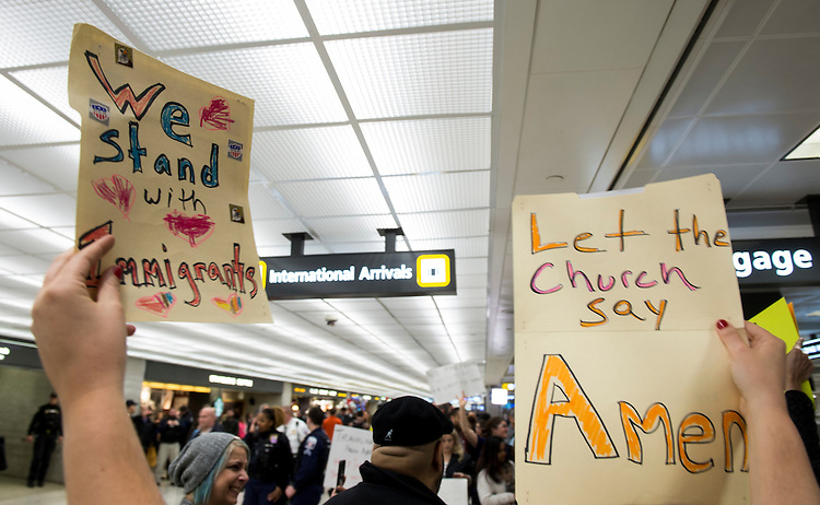 UNITED STATES - JANUARY 29: Protesters greet international travelers at Dulles International Airport in Virginia on Sunday, Jan. 29, 2017. Protests erupted at airports around the country following President Trump's executive order restricting travel from several Islamic countries. (Photo By Bill Clark/CQ Roll Call)