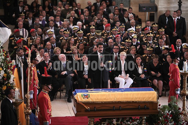 Nicolas Maduro , after swear as President of Venezuela, speaks next to the casket with the remains of Venezuelan leader Hugo chavez at the military academy in Caracas