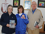 Joe and Gillian Shiels pictured with Boxer Deirdre Gogarty at her book signing at Drogheda Boxing club. Photo: Colin Bell/pressphotos.ie