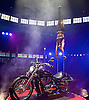 La Soiree<br /> at the La Soiree Spiegeltent, Southbank Centre, London, Great Britain <br /> press photocall<br /> 29th October 2015 <br /> <br /> Melanie Chy<br /> balance &amp; strength act on a motorcycle<br /> <br /> <br /> <br /> Photograph by Elliott Franks <br /> Image licensed to Elliott Franks Photography Services