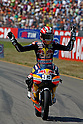 June 26, 2010 - Assen, Holland - Marc Marquez (Red Bull Ajo Motorsport) celebrates his victory after the Dutch Grand Prix at Assen, Holland, on June 26, 2010. (Photo Andrew Northcott/Nippon News)