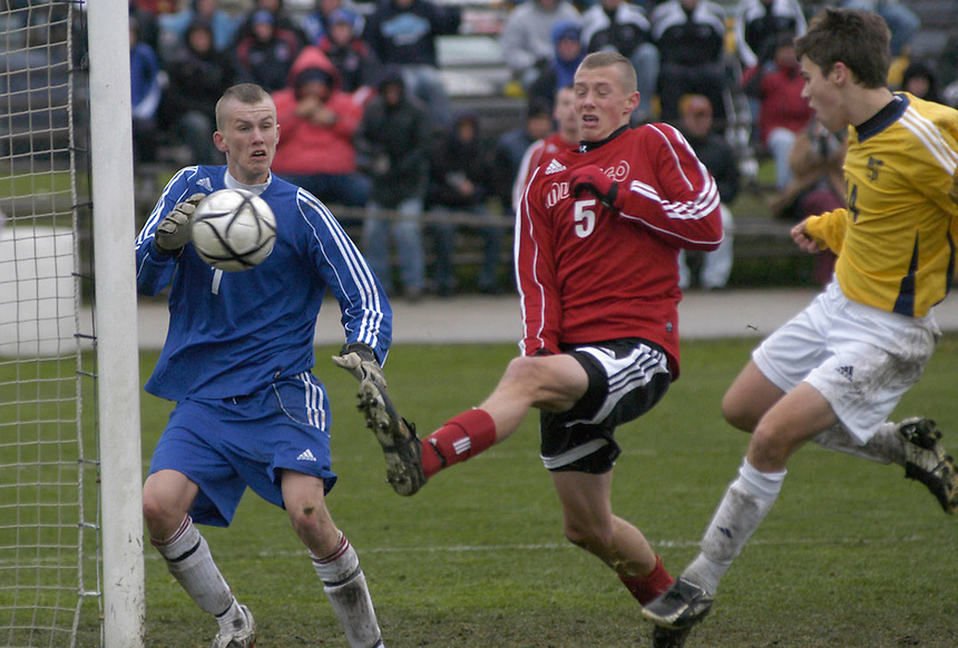 A Marquette University High School player scores against Mukwonago in the state soccer championship in Milwaukee in 2008.