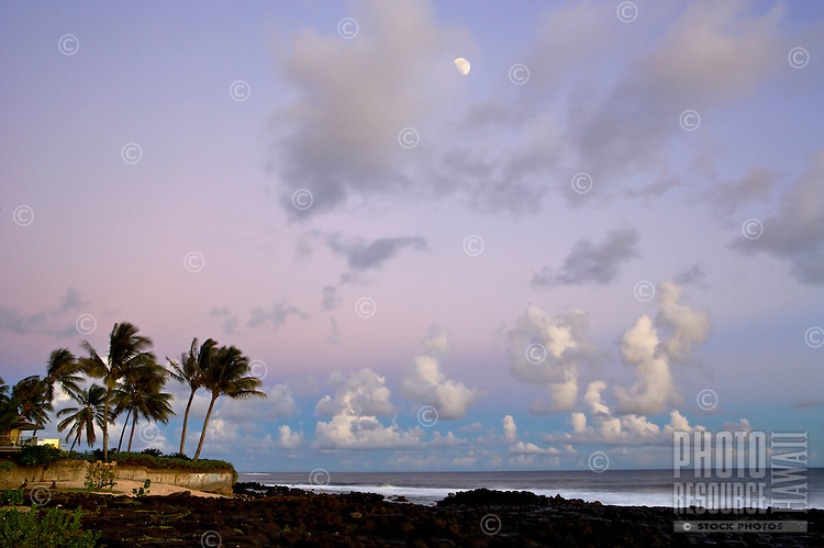 The earth shadow's purple and pink set the backdrop as the moon rises in Poipu, Kauai.