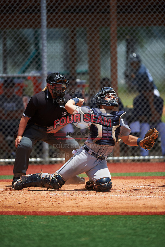 GCL Tigers West catcher Andres Sthormes (9) throws down to second as umpire Jennifer Pawol looks on during a game against the GCL Tigers East on August 4, 2016 at Tigertown in Lakeland, Florida.  GCL Tigers West defeated GCL Tigers East 7-3.  (Mike Janes/Four Seam Images)
