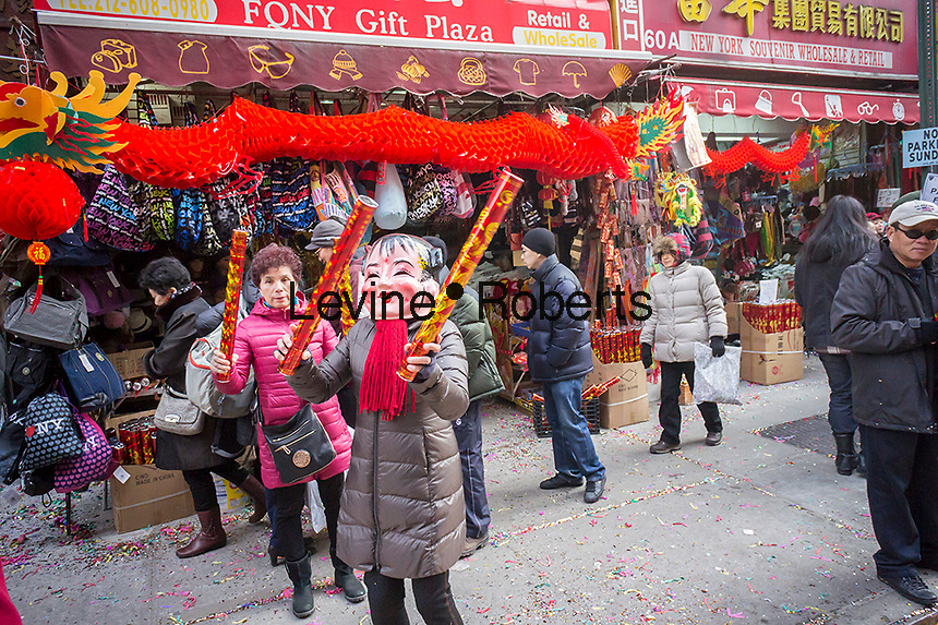 Souvenirs on sale in Chinatown in New York for Chinese New Year on Friday, January 31, 2014. The gala features dragon dancing troupes and other festivities ushering in the Year of the Horse, 4712 in the Lunar calendar. New York is deciding for the first time whether to decree Chinese New Year as a school holiday. The state requires schools to provide 180 days of instruction a year. On the Lunar New Year many Asian families do not send their children to school but take off the holiday to traditionally visit family and eating meals of auspicious foods.The city already suspends Alternate Side of the Street Parking. (© Richard B. Levine)