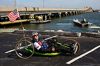 Morehead City, NC -- Portrait of quadriplegic hand cyclist Paul Kelly, 62, who trains for the Boston Marathon Tuesday, March 27, 2018. (Justin Cook for The Wall Street Journal)<br /> <br /> <br /> SUMMARY:<br /> <br /> Paul Kelly, hand cyclist, Beaufort, NC Training for the Boston Marathon so we would want to shoot in March to run the week before the marathon or marathon Monday, Apriln16. Life as a quadriplegic doesn't keep 62-year-old Paul Kelly on the sidelines. After breaking his neck in a swimming accident in 1978, Kelly was determined to find fitness activities to maintain an active lifestyle. He discovered handcycles while watching his niece compete in the 2006 Marine Corps Marathon and was inspired to start his own marathon career to stay fit. Paul has competed in over 100 half and full marathons. On April 16, he will celebrate his 40th year of living as a quadriplegic by taking on one of the most coveted races for a marathoner -- the Boston Marathon. Kelly is among the 60 handcyclists competing in the 2018 Boston Marathon with a qualifying time of 1:26:37. Most of Paul's distance training takes place at Bogue Banks, which includes Atlantic Beach, Salter Path, and Emerald Isle, N.C. It's Nicholas Sparks worthy scenery with its marshes, waterways, inlets and small islands. Paul is particularly fond of the approach from Atlantic Beach to Bogue Banks -- it's via the high-rise bridge. In cold weather, Paul has to be mindful of the environment and dress in a manner that insulates his legs while also allowing his upper body to ventilate. Paul chooses to train at times of day when the temperatures are more reasonable. He uses hand warmers in his gloves, on the inside the grips on his handcycle and in the legs of his trousers.