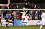 14 December 2007: Massachusetts' Zack Simmons (in yellow) grabs the ball off of the head of Ohio State's Xavier Balc (3). The Ohio State University Buckeyes defeated the University of Massachusetts Minutemen 1-0 at SAS Stadium in Cary, North Carolina in a NCAA Division I Mens College Cup semifinal game.