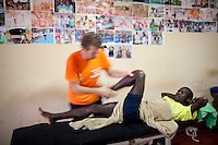Physio Jeroen Deen treating Abel Kirui in Iten, Kenya.