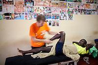 Physio Jeroen Deen treating Abel Kirui in Iten, Kenya.