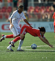 06 June 2009: Los Angeles Galaxy defender Tony Sanneh #22 gives Toronto FC forward Pablo Vitti #8 a push in MLS action at BMO Field Toronto in a game between LA Galaxy and Toronto FC. .The Galaxy  won 2-1.