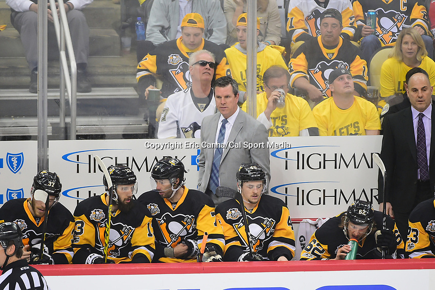 May 21, 2017: Pittsburgh Penguins head coach Mike Sullivan watches game action during game five of the National Hockey League Eastern Conference Finals between the Ottawa Senators and the Pittsburgh Penguins, held at PPG Paints Arena, in Pittsburgh, PA. Pittsburgh shuts out Ottawa 7-0 to lead the series 3-2.  Eric Canha/CSM