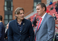 Wycombe Wanderers Manager Gareth Ainsworth chats to Leyton Orient Manager Ian Hendon during the Sky Bet League 2 match between Leyton Orient and Wycombe Wanderers at the Matchroom Stadium, London, England on 19 September 2015. Photo by Andy Rowland.