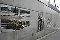 Nov 10, 2009 - Tokyo, Japan - A series of large pictures depicting the collapse of the Berlin Wall can be viewed along the wall of the German Embassy in Tokyo.