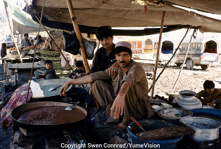 Read beans and rice in a street restaurant in Darra. Darra town in Pakistan clandestinely provides arms to more than eight Central Asian countries.