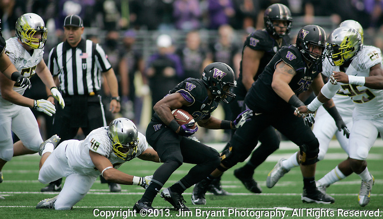 Washington Running back Bishop Sankey (25)  carries the ball against Oregon in a college football game at Husky Stadium in Seattle, Washington on October 12, 2013. Sankey rushed for 174 yards on 28 carries, caught five passes for 38 yards  and scored two touchdowns in the Huskies 45-24 loss to the Oregon Ducks .  © 2013. Jim Bryant Photo. All Rights Reserved.