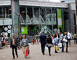 People in busy pedestrianised streets outside the city information centre Rotterdam, Netherlands