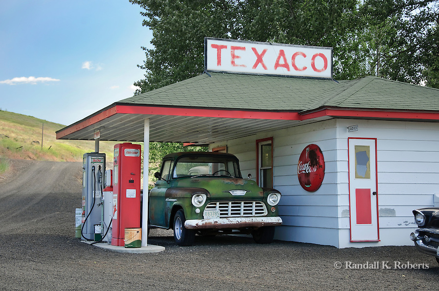 A restored gas station and antique truck serve as a reminder of days gone by on a small farm near St. John, Washington, Palouse Country.