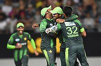 Haris Sohail and team mates celebrate the run out of Bruce.<br /> Pakistan tour of New Zealand. T20 Series.2nd Twenty20 international cricket match, Eden Park, Auckland, New Zealand. Thursday 25 January 2018. &copy; Copyright Photo: Andrew Cornaga / www.Photosport.nz