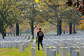 An unidentified man carries a rose and walks through Section 60 of Arlington National Cemetery on Veteran's Day, in Arlington, Virginia, USA, 11 November 2012. US President Barack Obama visited Section 60, 11 November, which is the final resting place for the majority of casualties at Arlington National Cemetery that died from Operation Iraqi Freedom in Iraq and Operation Enduring Freedom in Afghanistan..Credit: Michael Reynolds / Pool via CNP