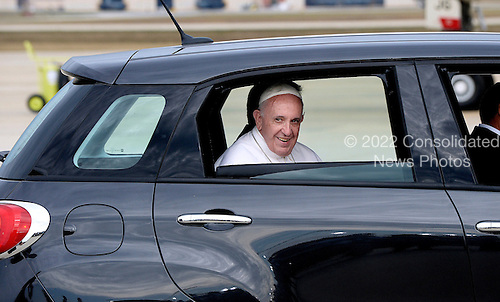 His Holiness Pope Francis is being transported to Washington D.C in a Fiat 500 at Joint Base Andrews in Maryland on September 22, 2015. The Pope is making his first trip to the United States on a three-city, five-day tour that will include Washington, D.C., New York City and Philadelphia. <br /> Credit: Olivier Douliery / Pool via CNP