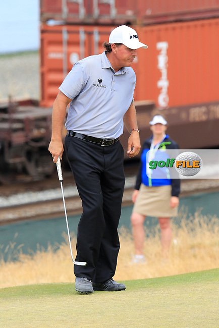 Phil MICKELSON (USA) on the 16th green as a freight train passes by during Thursday's Round 1 of the 2015 U.S. Open 115th National Championship held at Chambers Bay, Seattle, Washington, USA. 6/18/2015.<br /> Picture: Golffile | Eoin Clarke<br /> <br /> <br /> <br /> <br /> All photo usage must carry mandatory copyright credit (&copy; Golffile | Eoin Clarke)