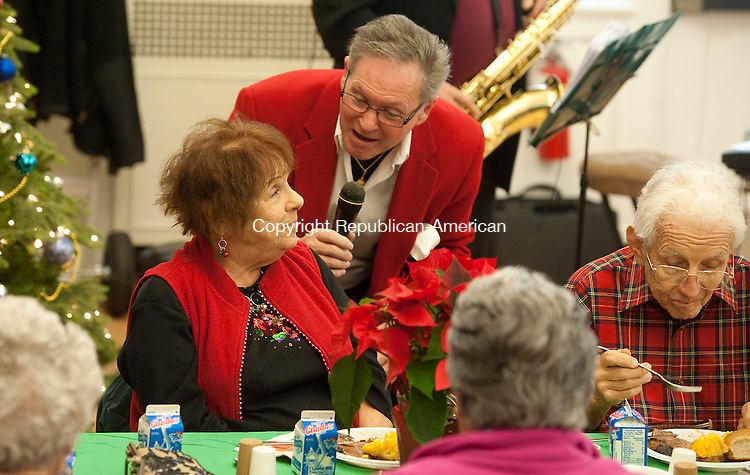MIDDLEBURY, CT--- -122115JS05--Musician Bob Lupi sings to guest Terri Sharkus of Oxford while entertaining the crowd during the annual Middlebury Senior Center's Christmas Luncheon held Monday at the Shepardson Community Center in Middlebury. <br /> Jim Shannon Republican-American