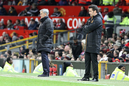 10.01.2017.  Old Trafford, Manchester, Lancashire, England. EFL Cup semi-final 1st leg, Manchester United versus Hull FC. Jose Mourinho, manager of Manchester United and Marco Silva, manager of Hull City follow the action from the technical area.