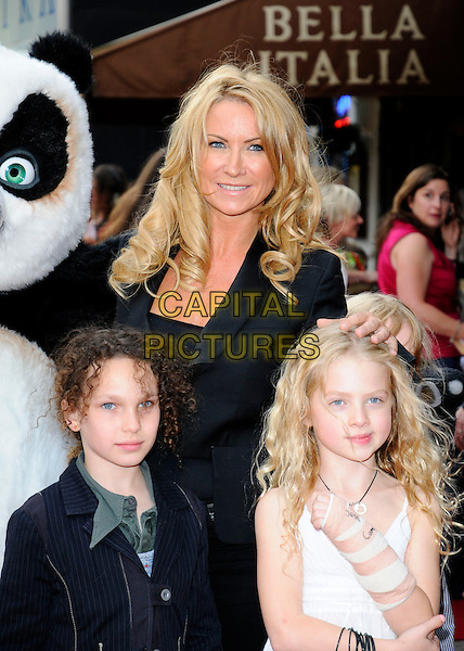 "MEG MATTHEWS & GUESTS .UK Premiere of ""Kung Fu Panda"" held at the Vue West End, London, England, UK, .June 26th 2008.half length kids children black hand on head jacket cast .CAP/CAN.©Can Nguyen/Capital Pictures."