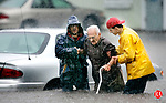WATERBURY, CT. 31 May 2006-060206SV12--David Gugliotti and Sajmon Gjyli of Bushka Lumber rescue Mario Fusco, 83, of Waterbury, from his car, as rising flood waters over took his vehicle on Fairfield Ave. during a heavy rain storm in Waterbury Friday.<br /> Steven Valenti Republican-American
