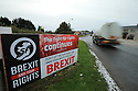 TO GO WITH BREXIT STORY BY WWILLIAM WALLIS DATE: 31 Jan 2019 - A truck passes a Sinn Fein Brexit sign in Dromintee in South Armagh, Northern Ireland. Photo/Paul McErlane