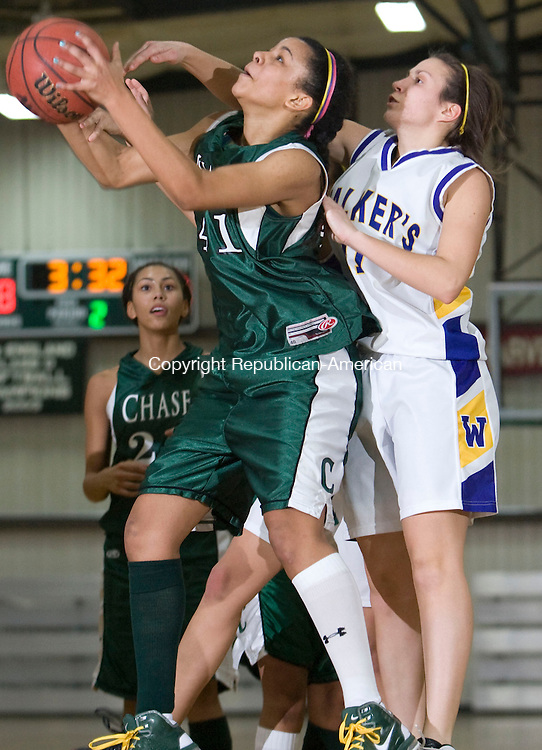 WATERBURY, CT - 07 FEBRUARY 2009 -020709JT03-<br /> Chase's Savannah Holness goes for a layup while under pressure from Ethel Walker's Caroline Kieltyka during Saturday's game at Chase. Chase won, 50-26.<br /> Josalee Thrift / Republican-American