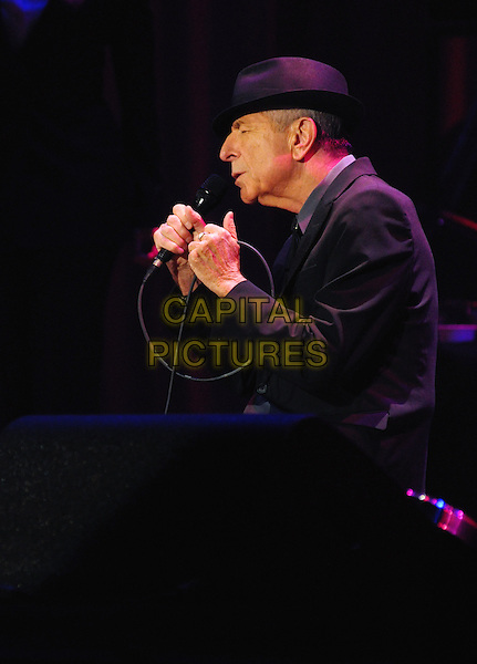 Leonard Cohen.Canadian songwriting legend Leonard Cohen performs on stage during his Old Ideas world tour held at Copps Coliseum, Hamilton, Ontario, Canada.  .April 9th, 2013.on stage in concert live gig performance performing music half length black suit hat singing side profile .CAP/ADM/BPC.©Brent Perniac/AdMedia/Capital Pictures