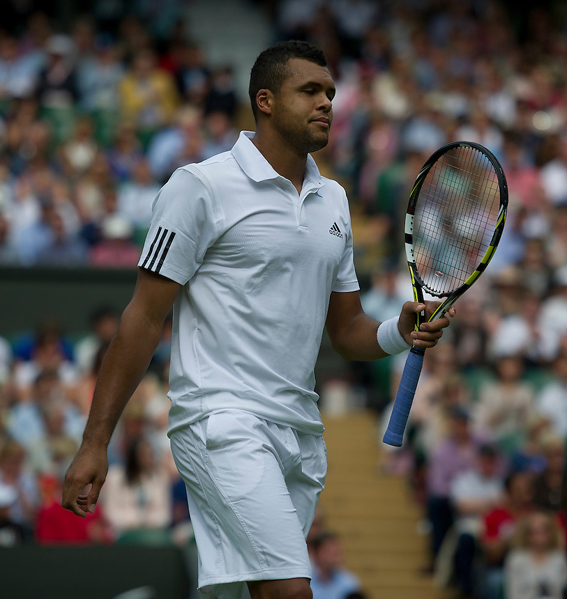 Jo-Wilfried Tsonga (FRA) in action during his defeat by Ernests Gulbis (LAT) in their Gentlemen's Singles Second Round match today - Ernests Gulbis (LAT) def Jo-Wilfried Tsonga (FRA) [6] 3-6 6-3 6-3 Ret. <br /> <br />  (Photo by Stephen White/CameraSport) <br /> <br /> Tennis - Wimbledon Lawn Tennis Championships - Day 3 Wednesday 26th June 2013 -  All England Lawn Tennis and Croquet Club - Wimbledon - London - England<br /> <br /> &copy; CameraSport - 43 Linden Ave. Countesthorpe. Leicester. England. LE8 5PG - Tel: +44 (0) 116 277 4147 - admin@camerasport.com - www.camerasport.com.