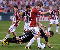 DC United forward Chris Pontius (13) gets taken down by Chivas USA midfielder Blair Gavin (18).  DC United defeated Chivas USA 3-2 at RFK Stadium, Saturday May 29, 2010.