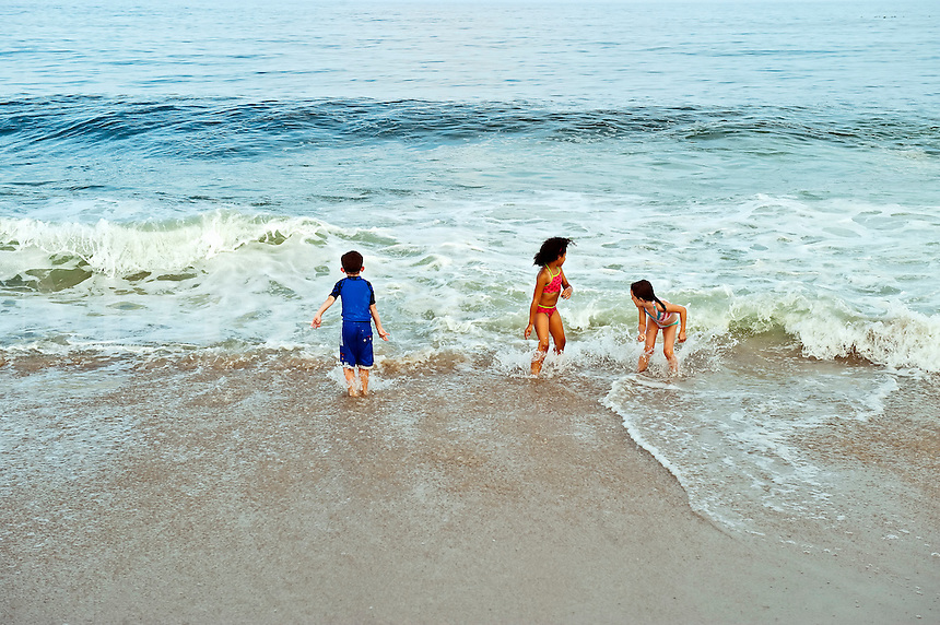 Children enjoy playing in the ocean surf, Cape Cod, MA