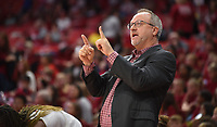 NWA Democrat-Gazette/DAVID GOTTSCHALK Arkansas Razorback head coach Mike Neighbors signals into the game against the University of New Orleans Privater Friday, November 8, 2019, during play at Bud Walton Arena in Fayetteville.