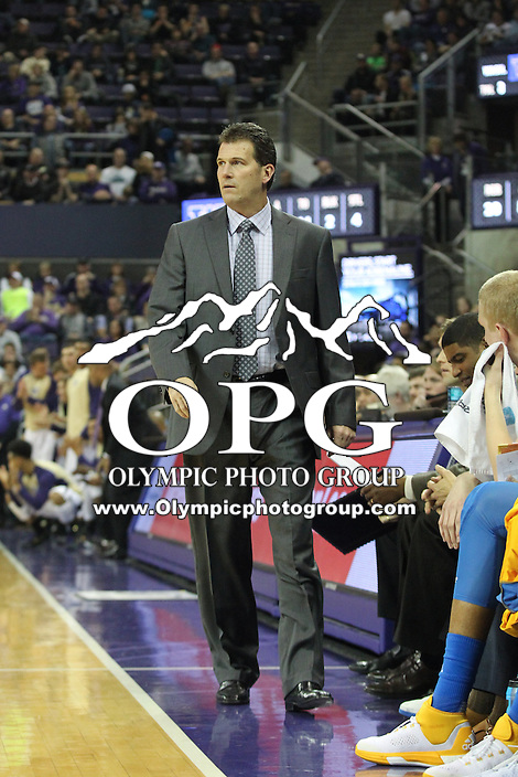JAN 1, 2016:   UCLA head coach Steve Alford watches his team from the bench against Washington.  Washington defeated #25 ranked UCLA 96-93 in double overtime at Alaska Airlines Arena in Seattle, WA.