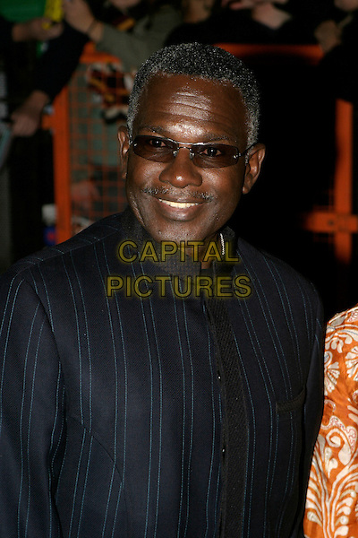 GUEST.Leaving The National Television Awards 2005 at the Royal Albert Hall, London, UK..October 25th, 2005.Ref: AH.headshot portrait sunglasses shades.www.capitalpictures.com.sales@capitalpictures.com.© Capital Pictures.