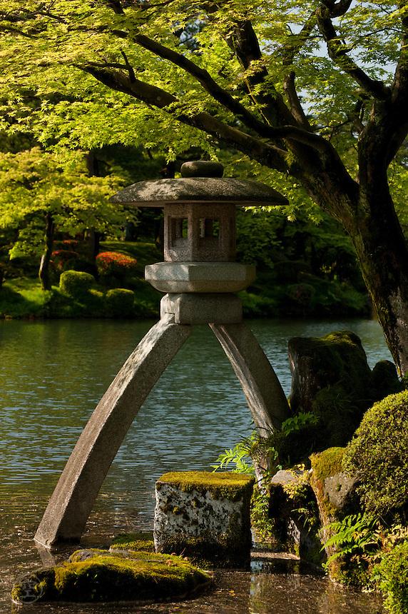 The famous Kotoji Toro lantern in spring morning light at Kenrokuen Garden, Kanazawa, Japan.
