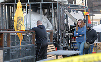 NWA Democrat-Gazette/DAVID GOTTSCHALK The remains of a downtown food truck is visible Friday, November 30, 2018, following a fire at 400 W. Dickson Street in Fayetteville. The Fayetteville Fire Department responded to a call at 6:21 a.m.. Battalion Chief Willie Watts said flames had engulfed one of the food trucks at the site, Wicked Wood Fired Pizza, when firefighters had arrived. Watts said there were no injuries but the food truck was a total loss and the YeeHawg building sustained some damage, as did a cargo trailer nearby.