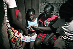 KINSHASA, DEMOCRATIC REPUBLIC OF CONGO - MAY 4: Esther Yandakwa (c), age 9, has fallen asleep after smoking marijuana in a drug house on May 4, 2006 in Matonge district in central Kinshasa, Congo, DRC. Esther is homeless and works as a prostitute together with four friends. The girls live outside next to a polluted river. Esther has been on the streets for about three years, and has been rejected by her family. From time to time, she lives in a homeless shelter for but doesn't like the rules there. She usually smokes cigarettes, marijuana and drinks whiskey. She charges the clients as little as US$ 1. About 15,000 children are estimated to live on the streets of Kinshasa. Congo, DRC is in ruins after forty years of mismanagement by the corrupt dictator and former president Mobuto Sese Seko. He fled the country in 1997 and a civil war started. The country is planning to hold general elections by July 2006, the first democratic elections in forty years. (Photo by Per-Anders Pettersson)