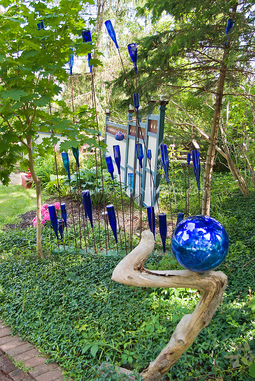 Blue glass bottle garden in shade